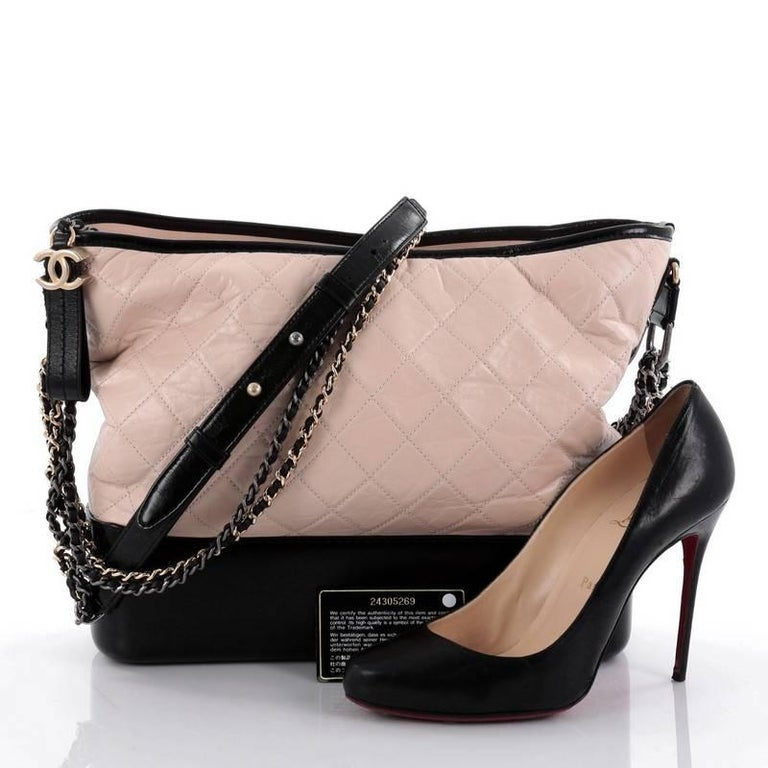 0c3e0a95b22e This authentic Chanel Gabrielle Hobo Quilted Calfskin Large displays a luxurious  design with timeless modernity.