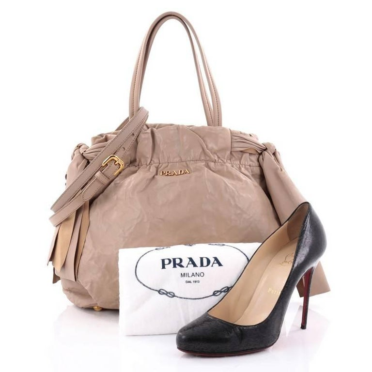 ee8dd21eef76 This authentic Prada Convertible Bow Tie Shoulder Bag Leather Medium is  elegant in its simplicity and