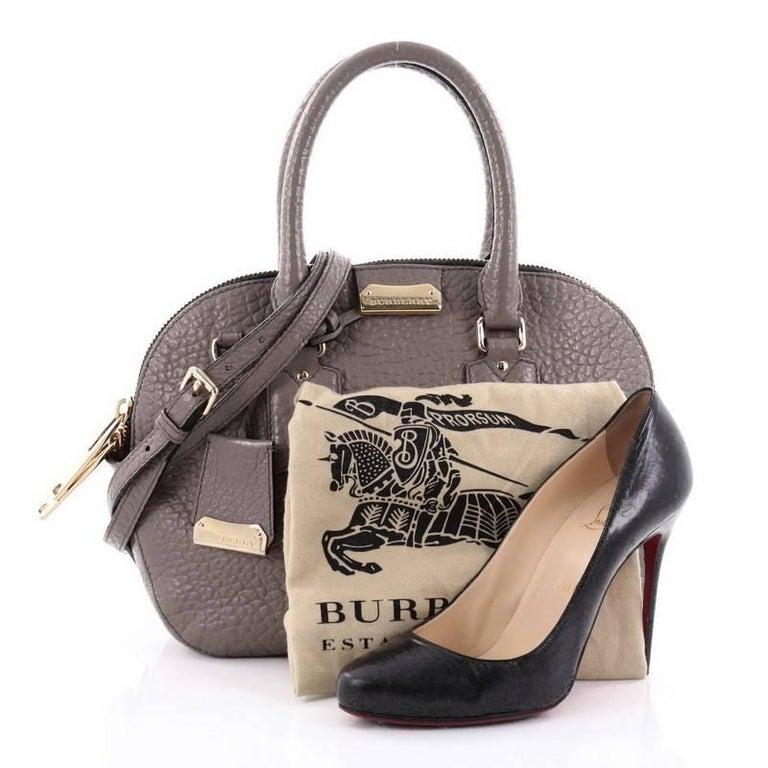 2da74d24e795 This authentic Burberry Orchard Bag Heritage Grained Leather Small has a  glamorous design with a roomy