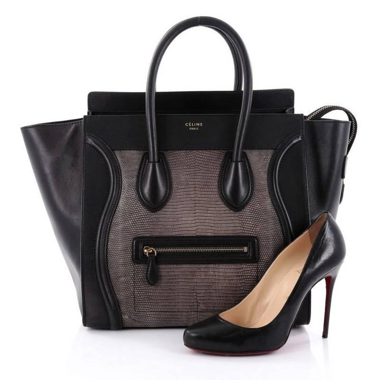 This authentic Celine Luggage Handbag Lizard and Leather Mini epitomizes Phoebe Philo's minimalist yet chic style. Constructed in genuine taupe lizard and black Leather, this beloved fashionista's bag features dual-rolled leather handles, a frontal