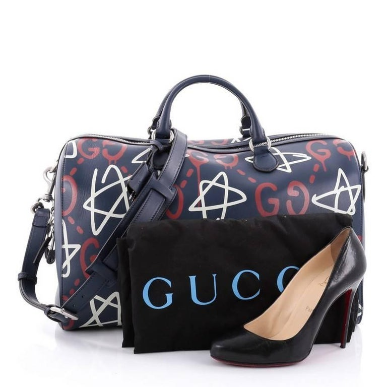 This authentic Gucci Convertible Duffle Bag GucciGhost Leather is a classic  travel bag with a youthful 7549afd384f