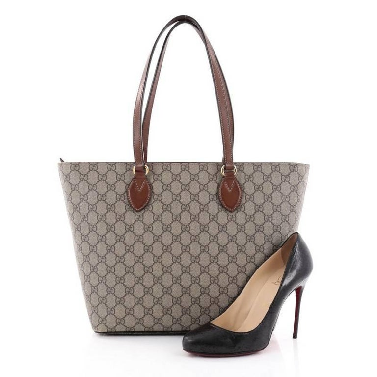 02539a3a8 This authentic Gucci Linea A Tote GG Coated Canvas Medium is an elegant bag  perfect for