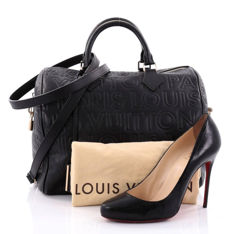 This authentic Louis Vuitton Paris Speedy Cube Bag Embossed Leather 30  presented in the brand s Fall 2b814a1ac9
