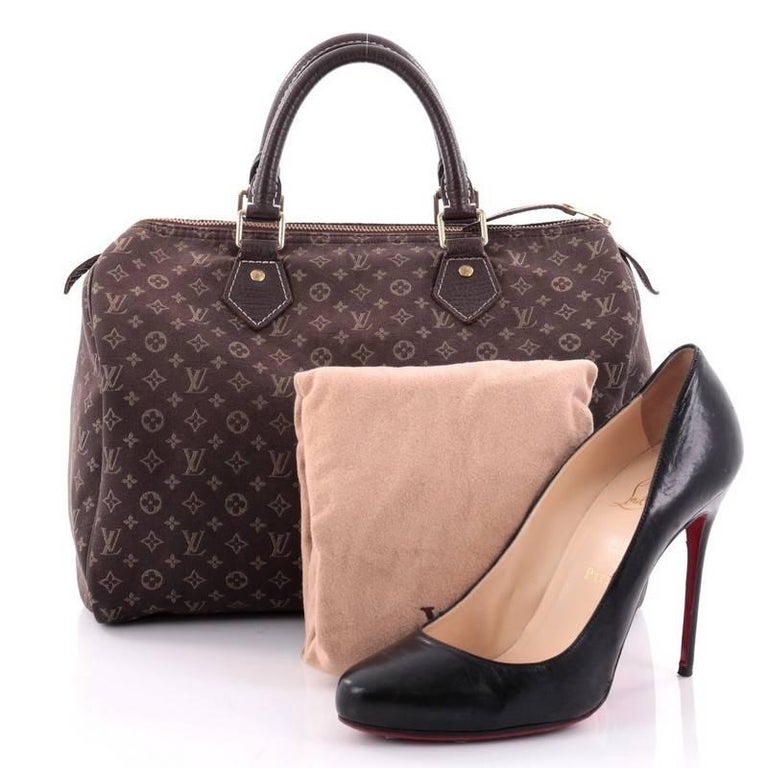 099ee1c7d8bf This authentic Louis Vuitton Speedy Handbag Mini Lin 30 is an elegant and  playful update to