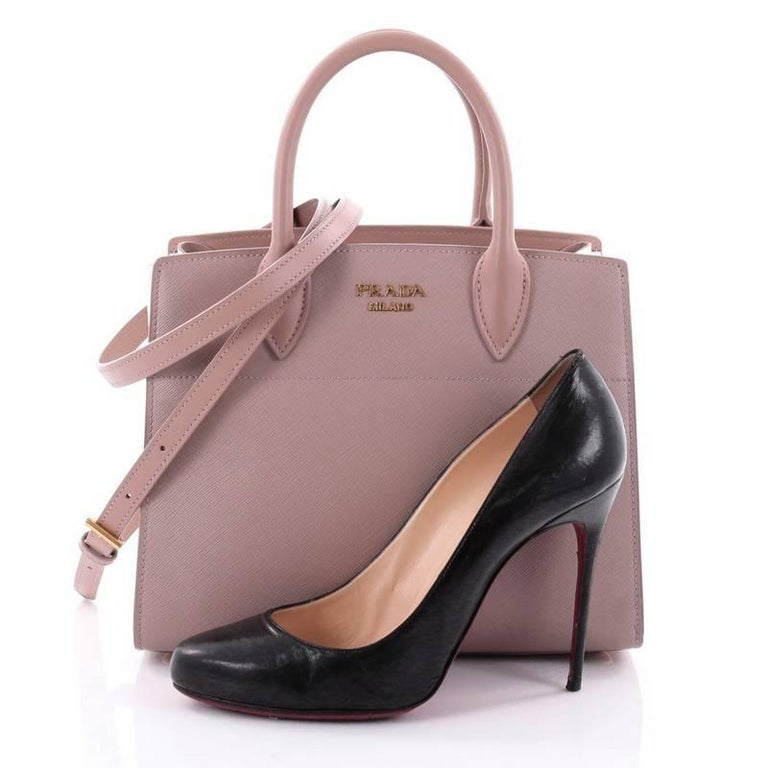 3eaf2222bf36 This authentic Prada Bibliotheque Handbag Saffiano Leather with City  Calfskin Small is a practical bag with