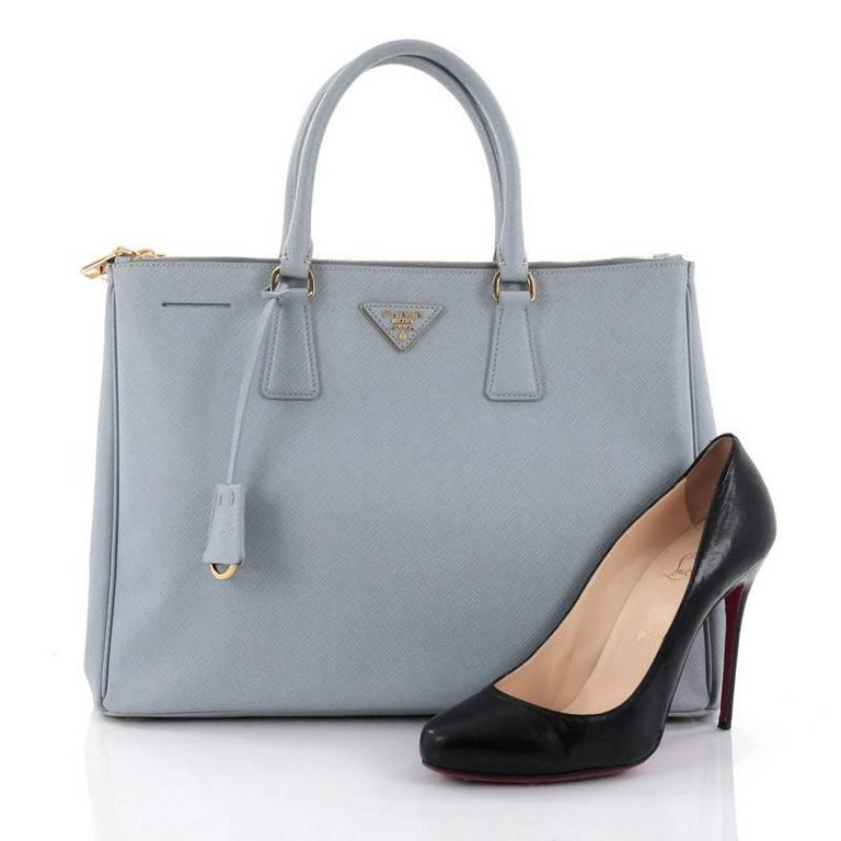 7ad4dc02078 This authentic Prada Double Zip Lux Tote Saffiano Leather Large is the perfect  bag to complete