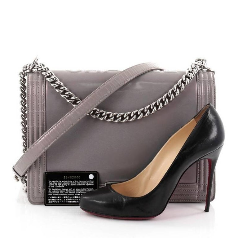 394b5854768959 This authentic Chanel Reverso Boy Flap Bag Glazed Calfskin Large is every  woman's dream. Crafted