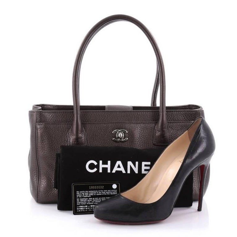 4ffe67a0945349 This authentic Chanel Cerf Executive Tote Leather Small is an ideal  everyday accessory for the modern