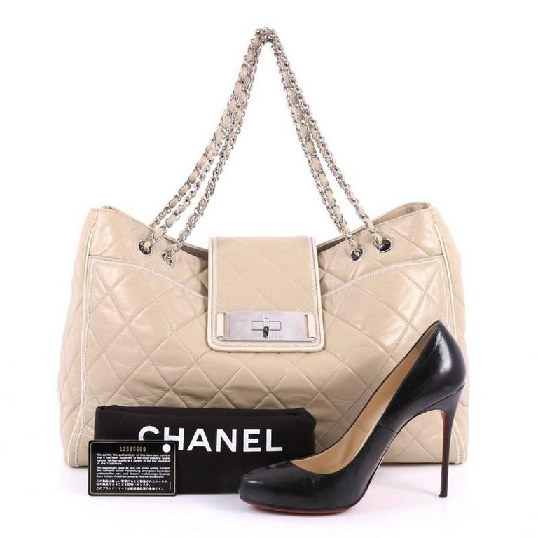 b999ac3c20 This authentic Chanel Mademoiselle Lock East West Tote Quilted Leather Large  is an elegant, classic