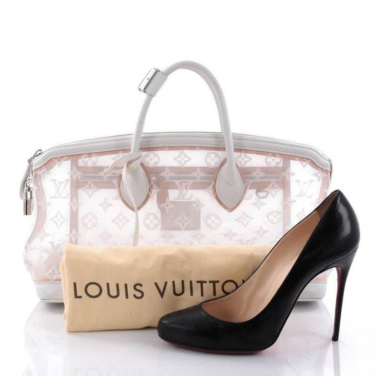This authentic Louis Vuitton Transparence Lockit Handbag Mesh and Leather is a chic and timeless piece perfect for day or evening excursions. Crafted from lovely monogram stitched transparent mesh with white leather trims, this bag features