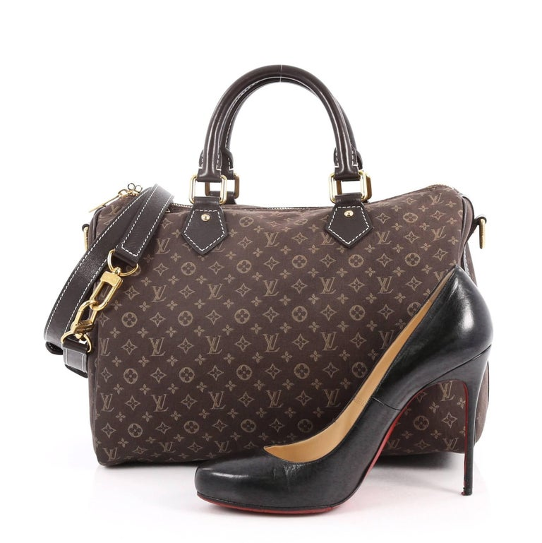 f7a38051cf51 This authentic Louis Vuitton Speedy Bandouliere Bag Monogram Idylle 30 is a  sporty must-have