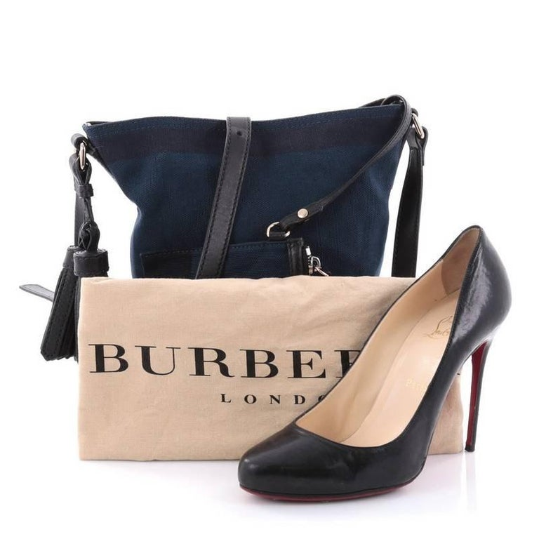 a03ede4425f0 This authentic Burberry Ashby Handbag House Check Canvas Mini in  sophisticated and classic design is ideal