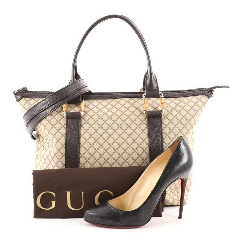 36e3861f5e4993 This authentic Gucci Bamboo Convertible Zip Top Tote Diamante Canvas Medium  is for everyday casual looks