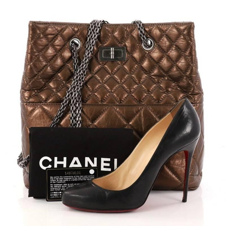 This authentic Chanel Reissue Tote Quilted Aged Calfskin Tall is a marvelous tote perfect for your everyday looks. Crafted from bronze quilted aged calfskin, this timeless bag features Chanel's signature reissue chain straps, diamond quilted design,