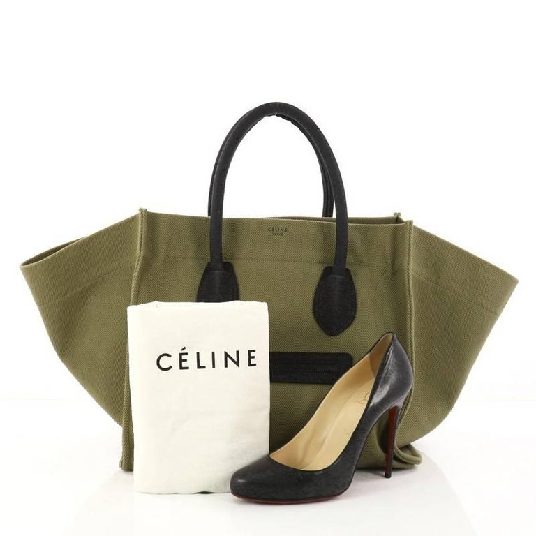 ... This authentic Celine Phantom Handbag Canvas Large is one of the most  sought-after bags ... c1bb4fd7aeb2a