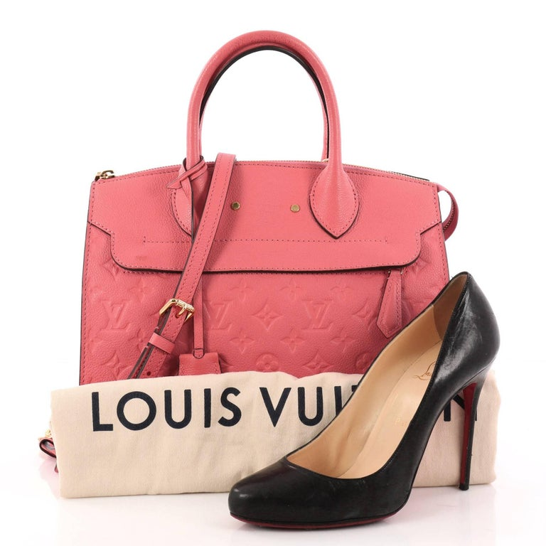 This authentic Louis Vuitton Pont Neuf Handbag Monogram Empreinte Leather MM is a modern structured bag. Constructed in sturdy pink monogram empreinte leather, this simple and functional bag showcases dual rolled leather handles, protective base