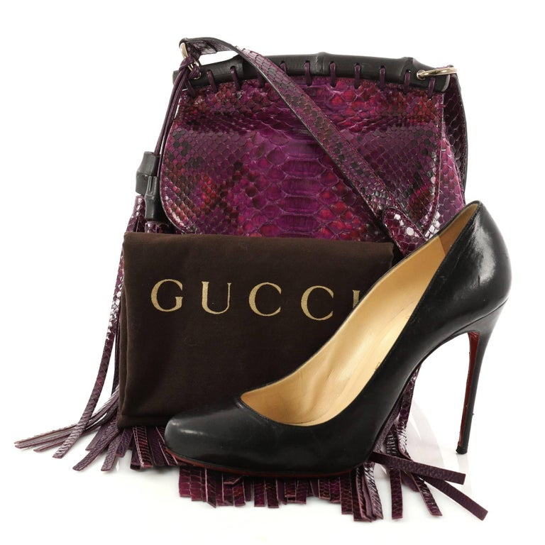 620f1ad03 This authentic Gucci Nouveau Fringe Crossbody Bag Python Small mixes  boho-inspired style with classic