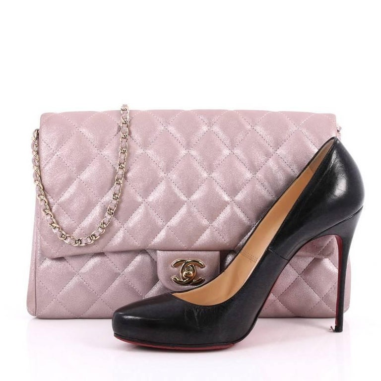 8123c3b8c071b6 This authentic Chanel Clutch with Chain Quilted Pearlescent Calfskin is an  elegant accessory that adds a
