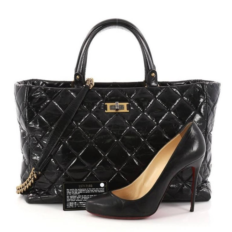 ce118012392629 This authentic Chanel Rita Tote Quilted Glazed Crackled Calfskin Small  presents a classic and timeless style