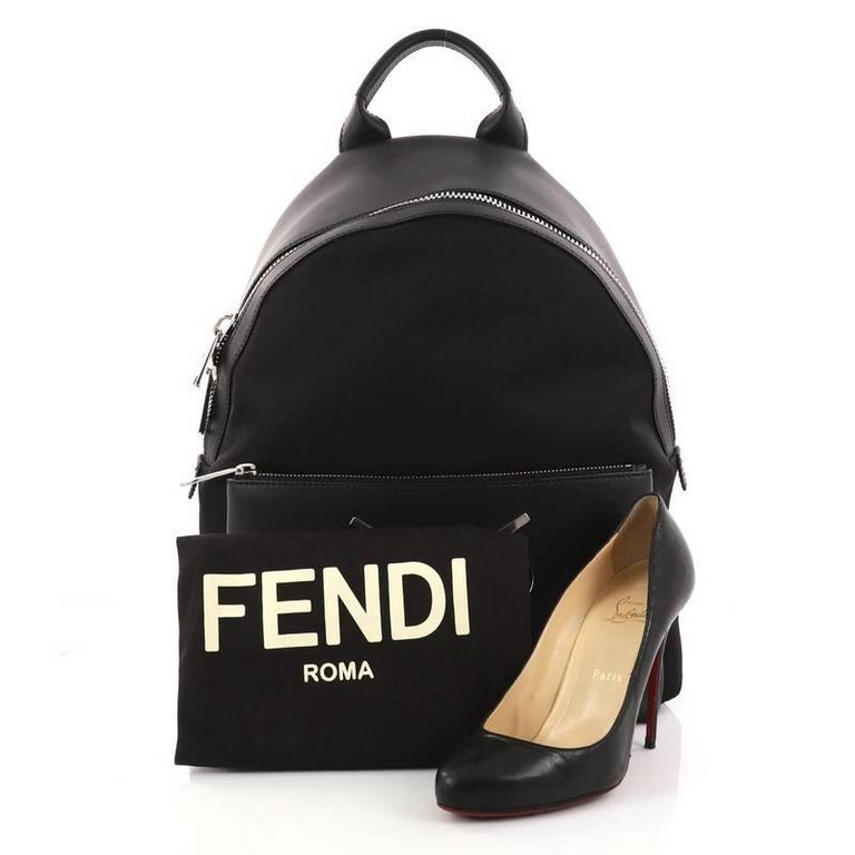 This authentic Fendi Faces Backpack Nylon and Leather is a stylish and unique backpack perfect for your daily excursions. Crafted from black nylon with calf leather, this backpack features rolled leather handles, adjustable flat padded fabric