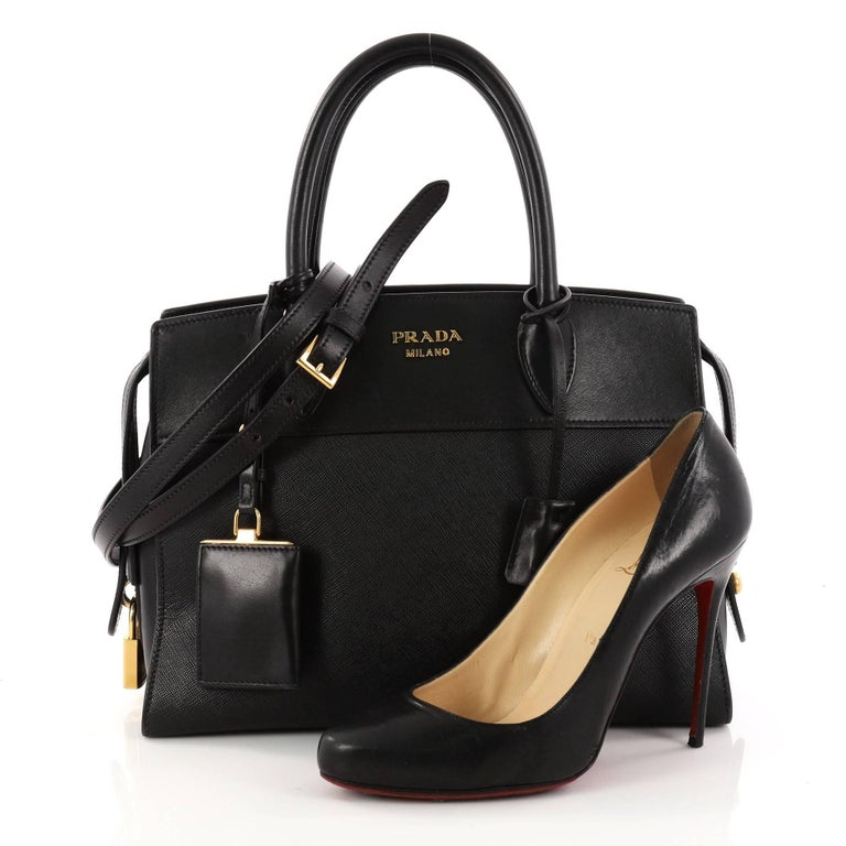 b9303d7374b116 This authentic Prada Esplanade Handbag Saffiano Leather Medium is a chic bag  perfect for the modern
