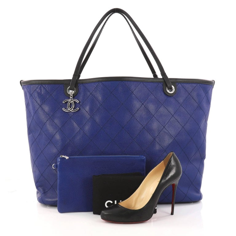 b203470d882fdb This authentic Chanel Fever Tote Quilted Caviar XL is perfect for everyday  use. Crafted in
