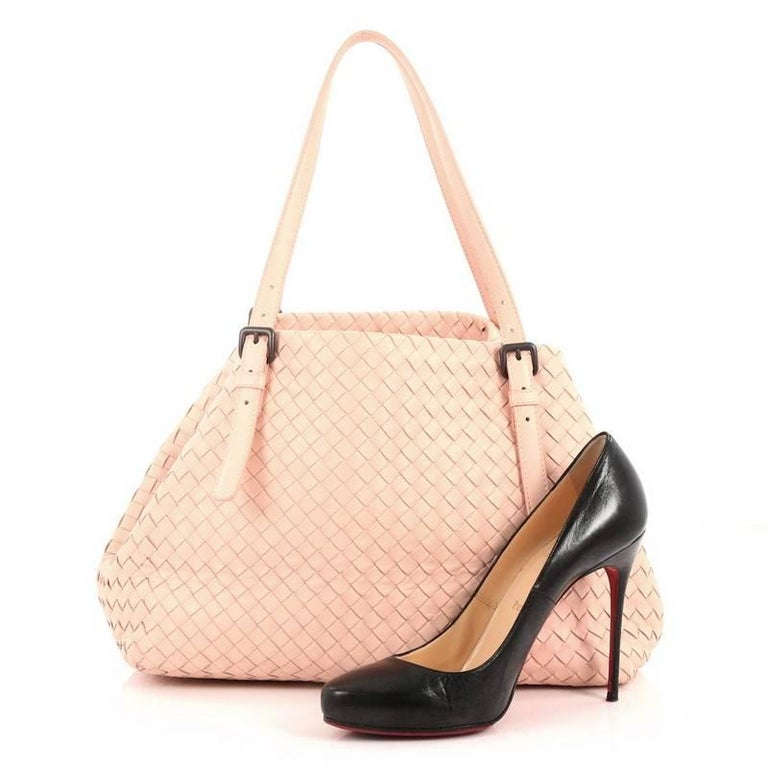 This authentic Bottega Veneta A-Shape Tote Intrecciato Nappa Medium is a statement piece you can surely take from day to night. Crafted in light pink leather woven in Bottega Veneta's signature intrecciato method, this stylish tote features