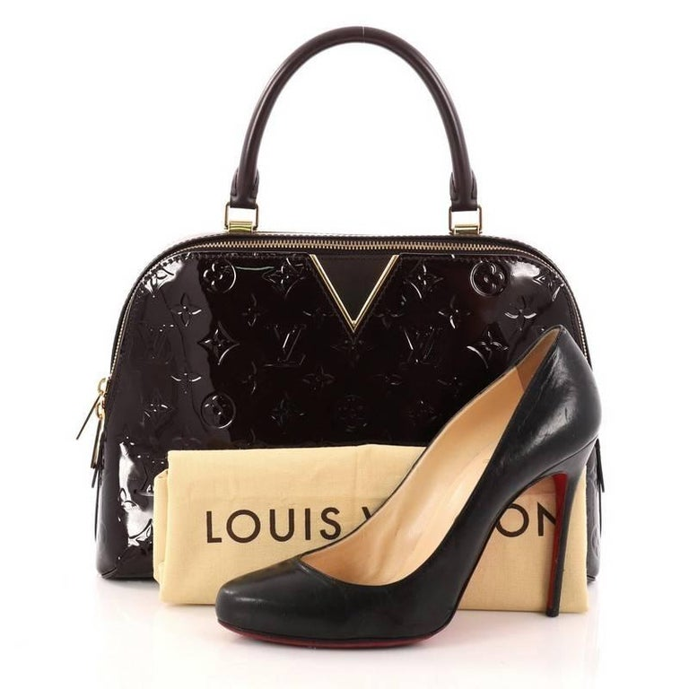 75cd910203d This authentic Louis Vuitton Melrose Handbag Monogram Vernis is an updated  version of the classic Melrose