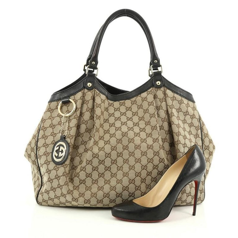 edf15714e78 This authentic Gucci Sukey Tote GG Canvas Large is perfect for any casual  or sophisticated outfit
