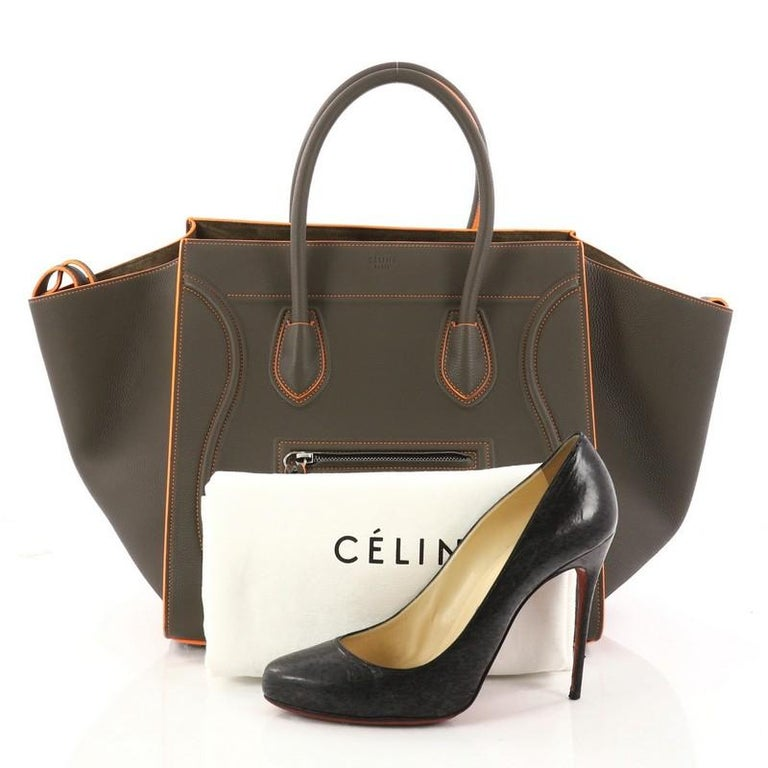 bcba3fd08af This authentic Celine Phantom Handbag Grainy Leather Medium is one of the  most sought-after