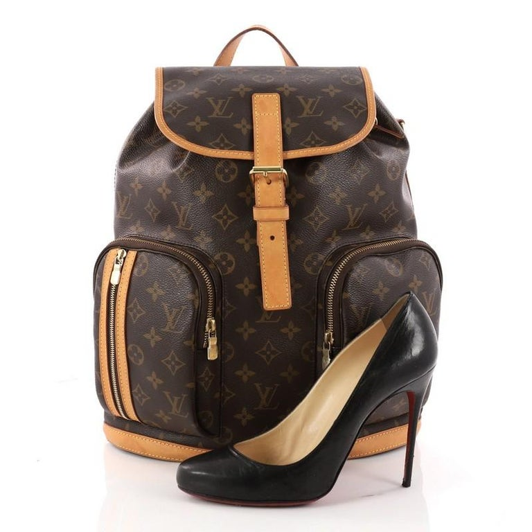 This authentic Louis Vuitton Bosphore Backpack Monogram Canvas is perfect for on-the-go fashionistas. Crafted from Louis Vuitton's brown monogram coated canvas with vachetta leather trims, this chic backpack features exterior front zip pockets, dual
