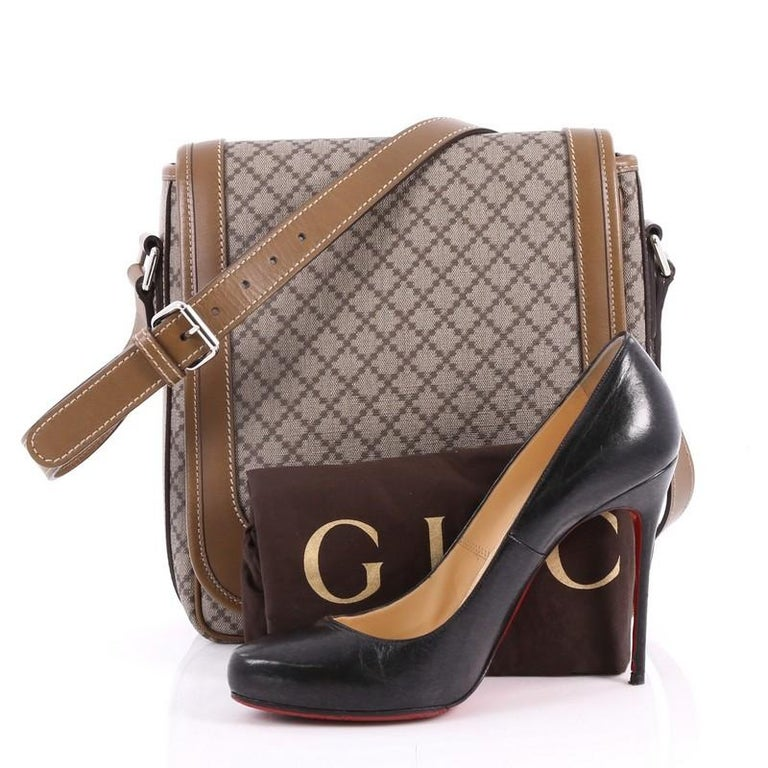 1e9fd54548dd79 This authentic Gucci Snap Flap Messenger Bag Diamante Coated Canvas Medium  is a classic piece for