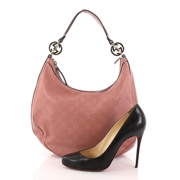 3ca4661f3fb0 This authentic Gucci Twins Hobo Guccissima Leather Medium is designed with  a classic and feminine twist