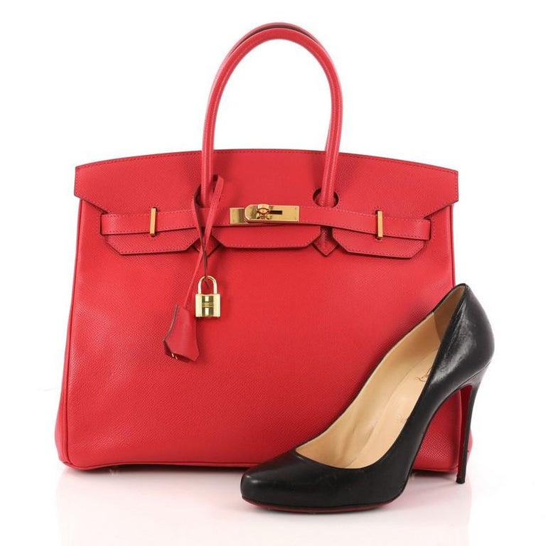 This authentic Hermes Birkin Handbag Rouge Vif Epsom with Gold Hardware 35 stands as one of the most-coveted accessory made for the modern woman. Crafted from Rouge Vif epsom leather, this stand-out tote features dual-rolled top handles, frontal