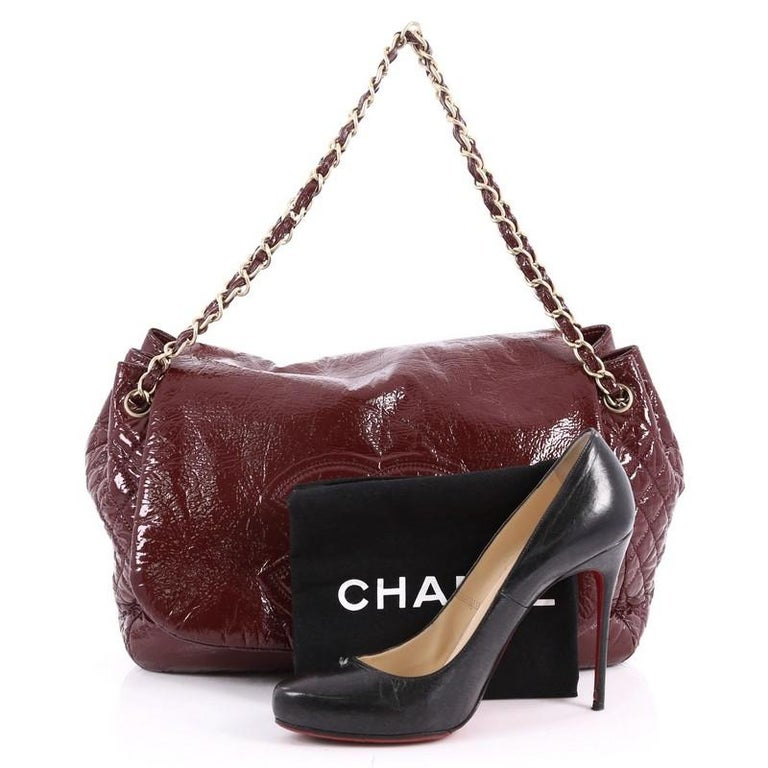 fcd6b8ac0fce This authentic Chanel Rock and Chain Flap Bag Patent Vinyl Large boasts an  oversized stature perfect