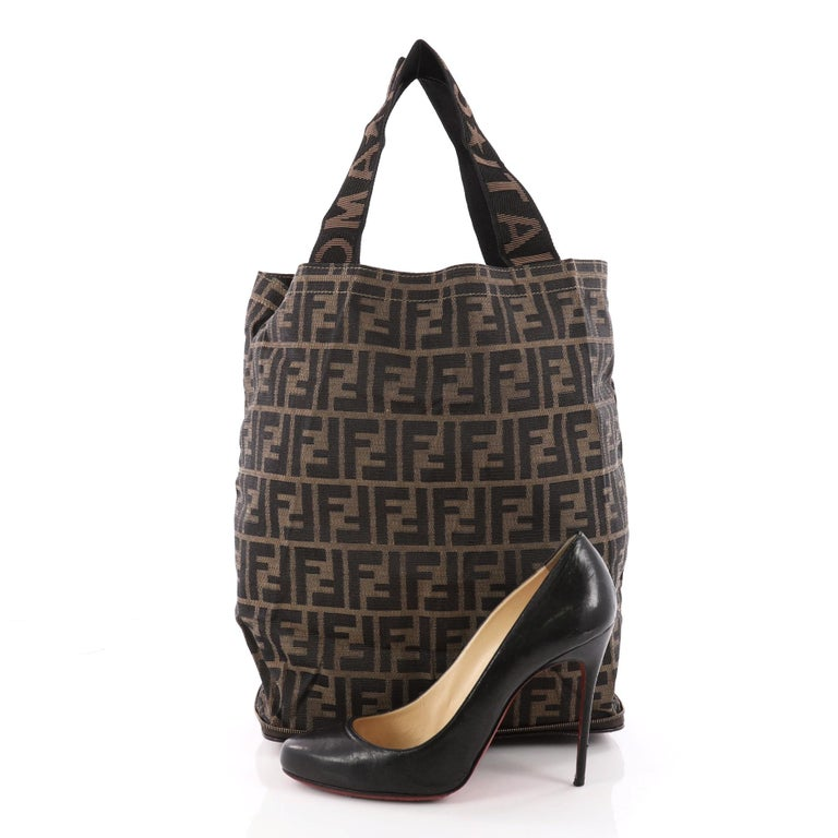 eb73177e0cf This authentic Fendi Vintage Convertible Shopping Tote Zucca Canvas Medium  is simple and classic ideal for