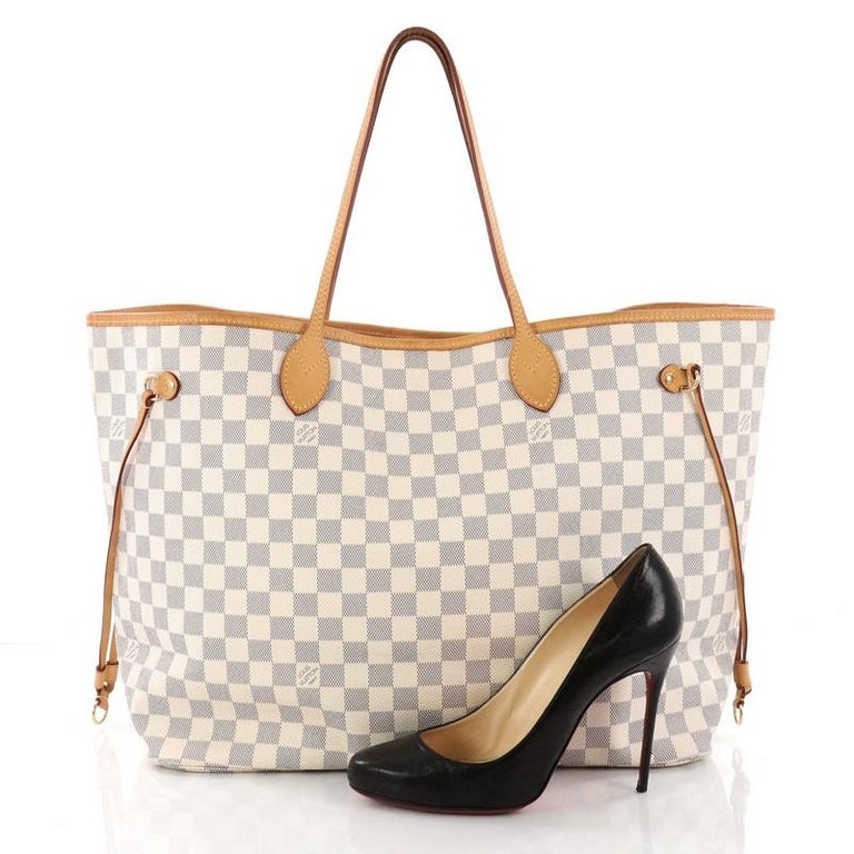 3d1d2e508bcf This authentic Louis Vuitton Neverfull Tote Damier GM is a popular and  practical oversized tote beloved