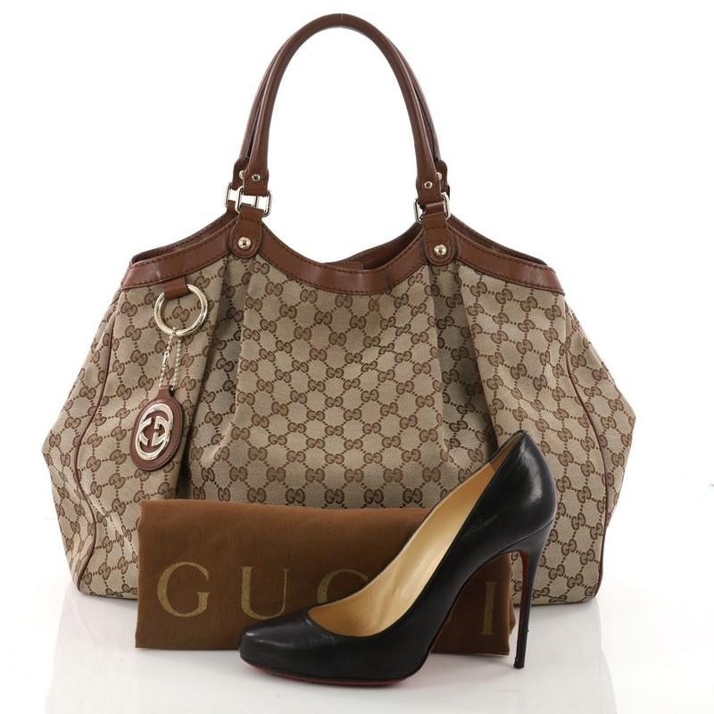 69fefc12c74 This authentic gucci sukey tote canvas large is perfect for any casual or  sophisticated outfit jpg