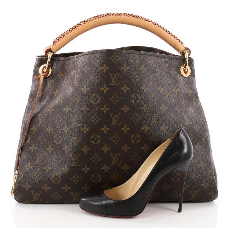 This Authentic Louis Vuitton Artsy Handbag Monogram Canvas Mm Is An Elegant And Iconic Bag That