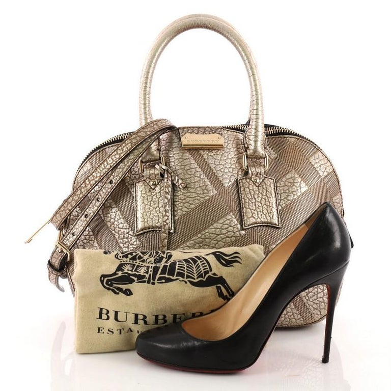 9c015e35a644 This authentic Burberry Orchard Bag Embossed Check Leather Small has an  elegant and simplistic design with