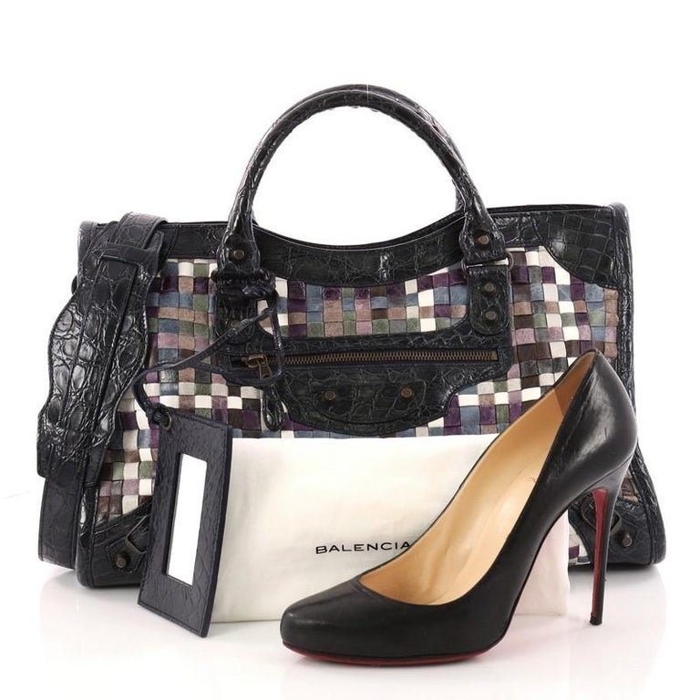 4ded1a04245 This authentic Balenciaga City Classic Studs Handbag Woven Crocodile  Embossed Leather Medium updates the classic city