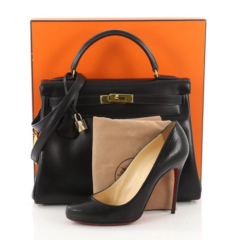 8780385b58a This authentic Hermes Kelly Handbag Black Box Calf with Gold Hardware 32 is  as classic and