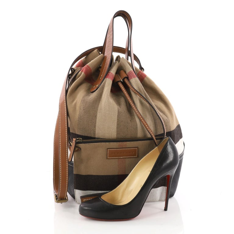 8d8a192c5648 This authentic Burberry Heston Bucket Bag House Check Canvas with Leather  Medium is a stylish bag
