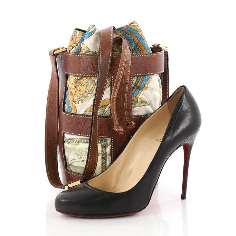62b53d5181 This authentic Salvatore Ferragamo Bucket Bag Leather and Quilted Printed  Canvas Medium is an elegant and