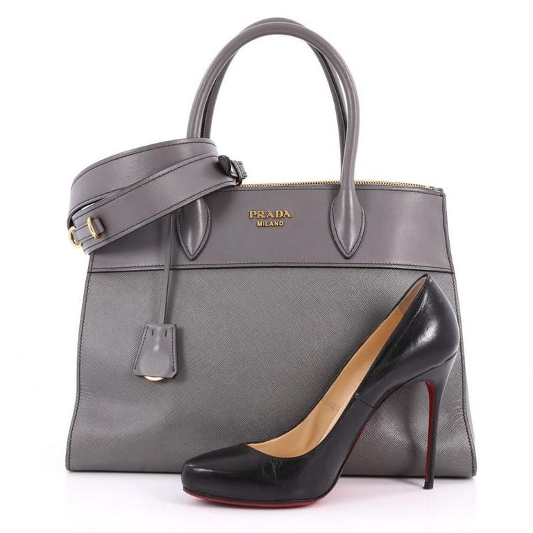 4d81909416d7e2 This authentic Prada Paradigme Handbag Saffiano Leather Medium is a  timeless classic. Crafted from grey