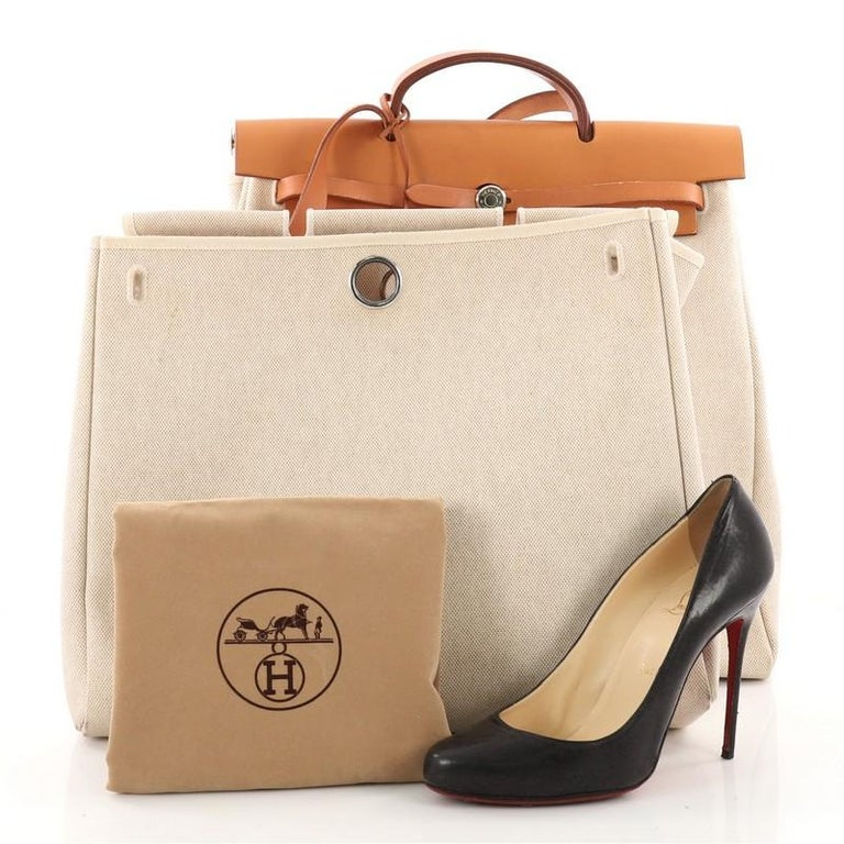4dd8dfe085ac This authentic Hermes Herbag Toile and Leather MM is a fabulously  functional Hermes set with two