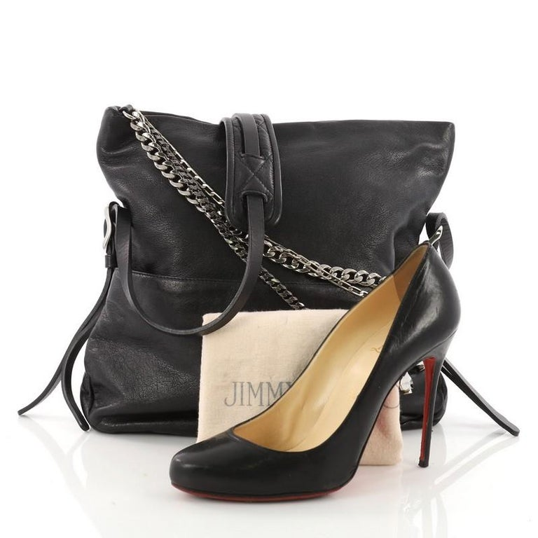 64b34a44608 This authentic Jimmy Choo Biker Crossbody Bag Leather Small mixes casual  style with a little bit