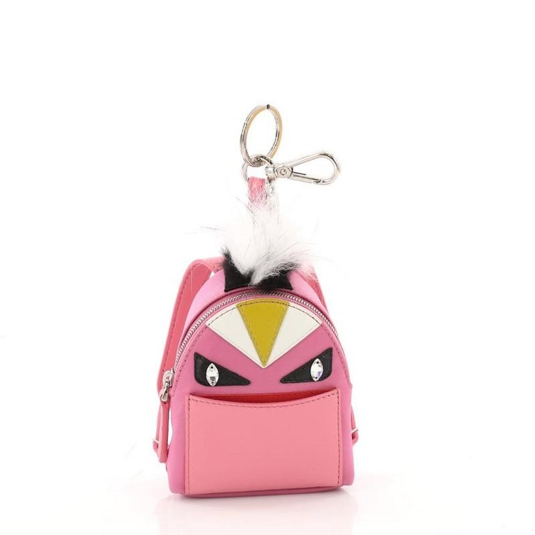 This authentic Fendi Monster Backpack Charm Nylon and Leather Micro balances a luxurious and playful style made for on-the-go fashionistas. Crafted from pink nylon, this backpack features Fendi's popular monster design in leather and fur accents,