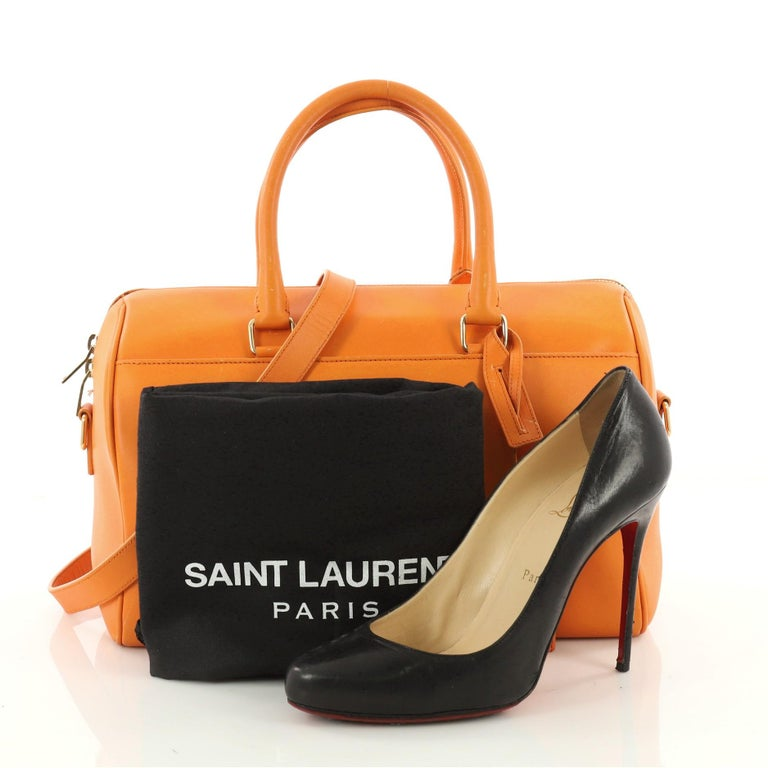 85698b5ad9b This authentic Saint Laurent Classic Duffle Bag Leather 12 is a sleek miniature  bag. Crafted