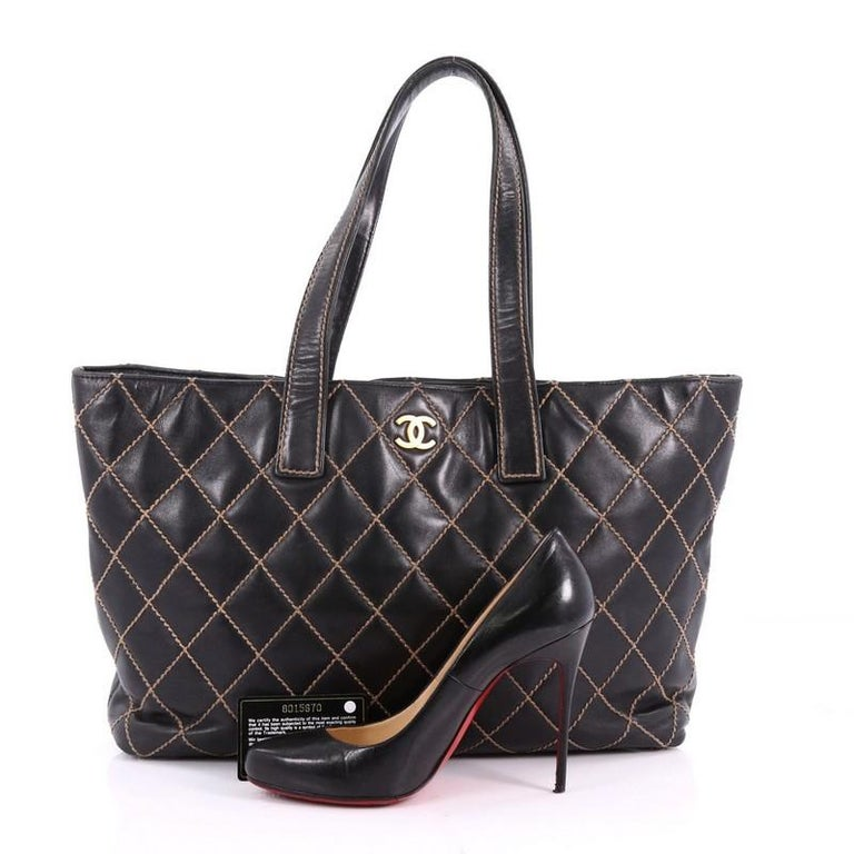 7f5dde0419d834 This authentic Chanel Surpique Tote Quilted Leather Large is a chic and  luxurious bag perfect for